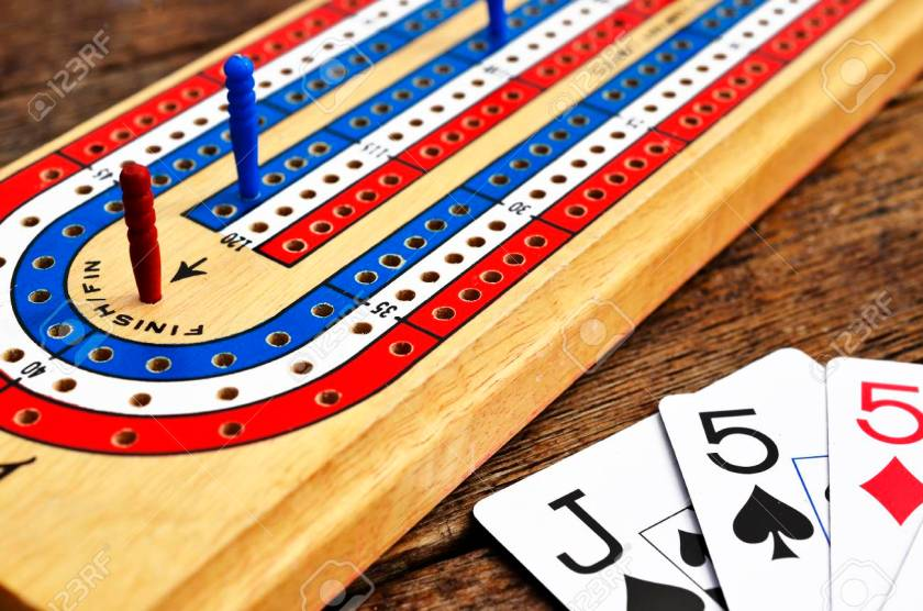 cribbage board close-up of winning peg and partial hand